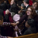 PEOPLE EXCHANGE SIGN OF PEACE DURING CHRISTMAS EVE MASS AT NATIONAL SHRINE IN WASHINGTON