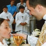 Priest Distributing Holy Communion Square Pic