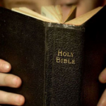 Holy Bible Being Held Binding Facing Wide Pic