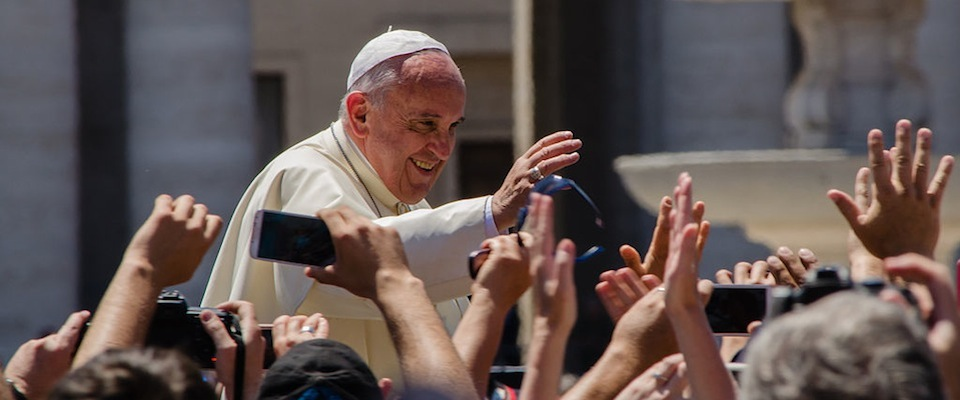 Pope Francis waving to crowd smiling outside sunny