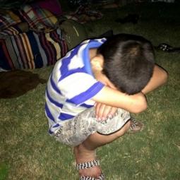 Young Iraqi Christian Boy Fleeing Exhausted Slumped Over
